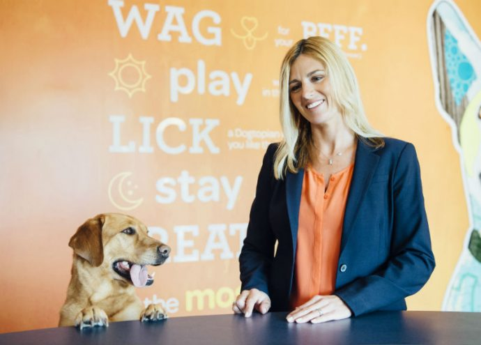 Owner dropping-off a dog at Dogtopia of Pittsburgh - Eastside reception desk.
