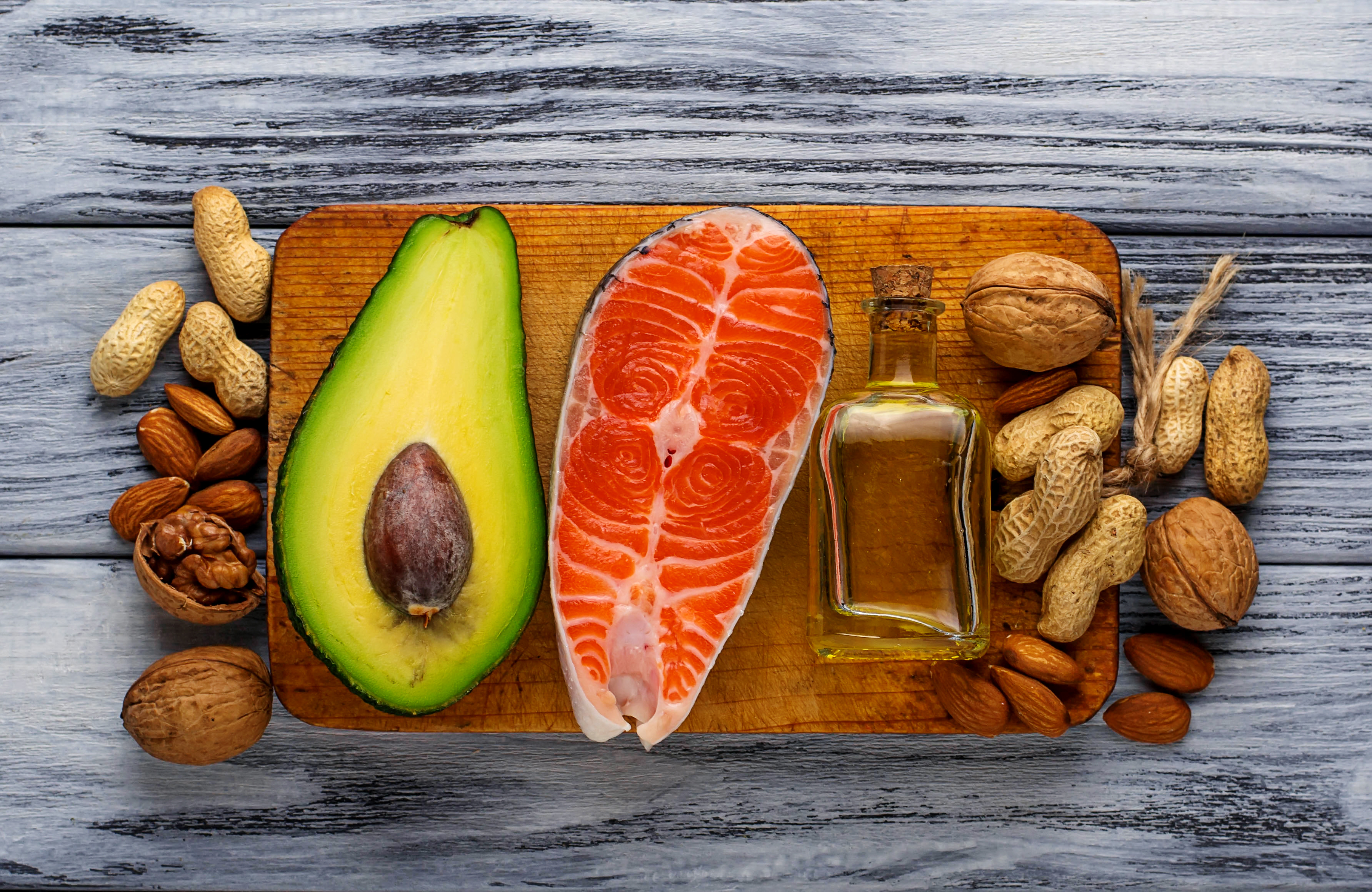 Healthy fat salmon, avocado, oil, nuts. Selective focus