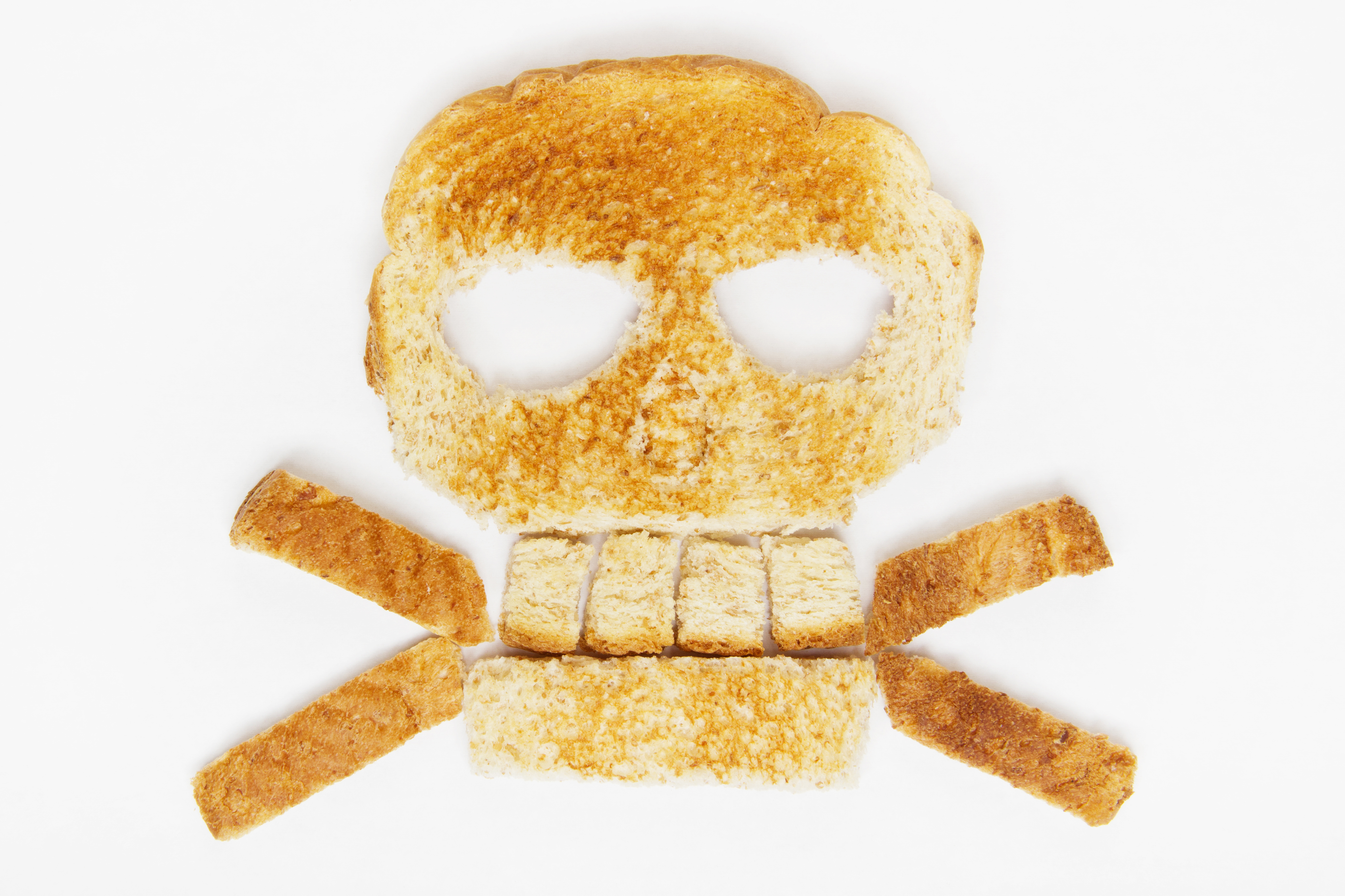 Stock image of bread skull and crossbones on white background