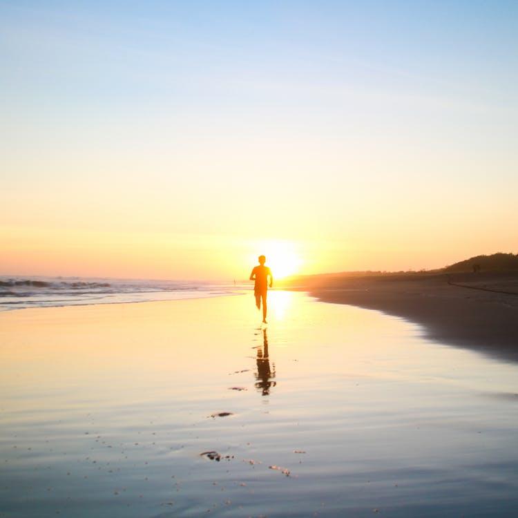running beach sunset stress