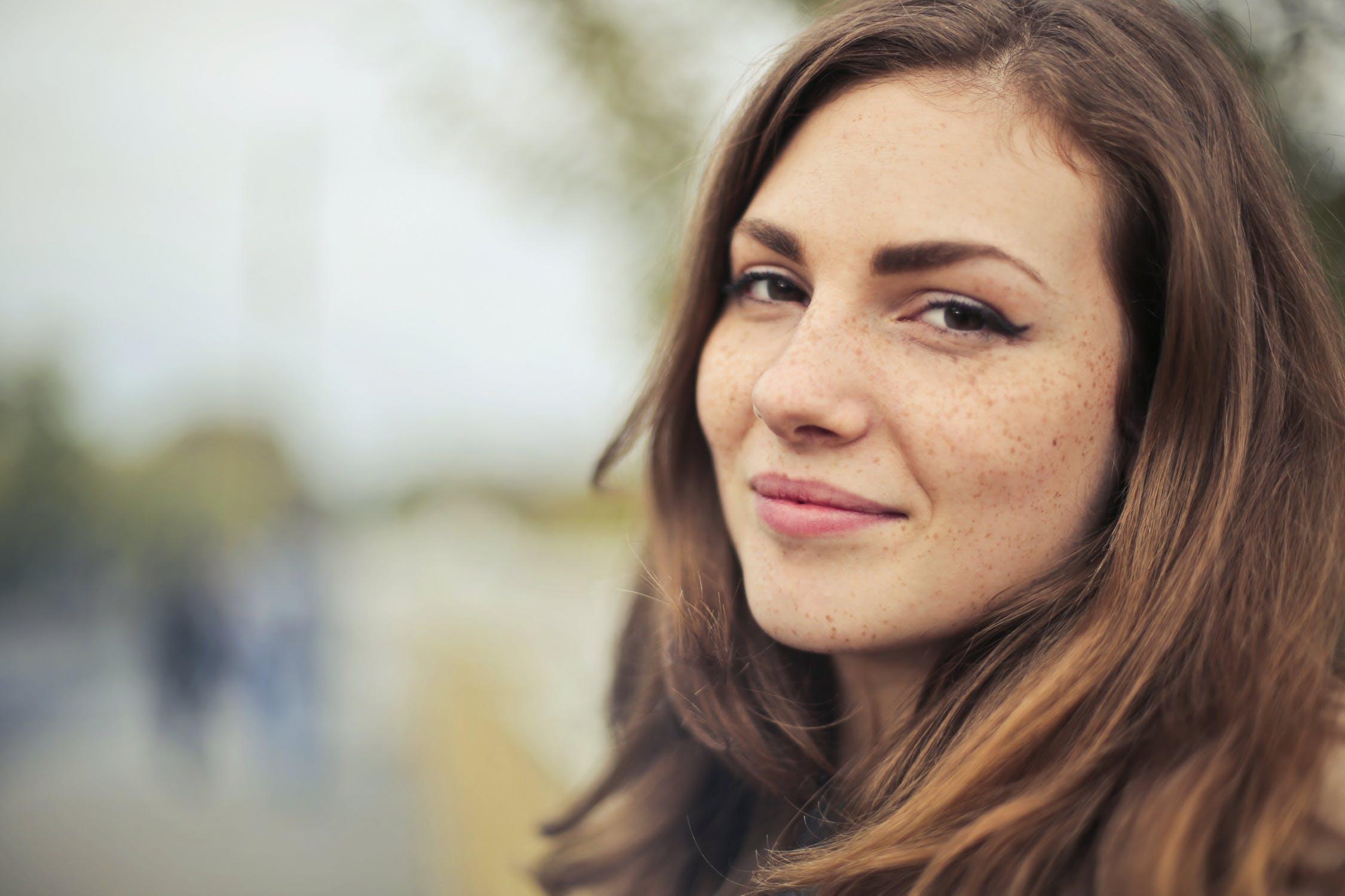 woman breaste health happy freckles