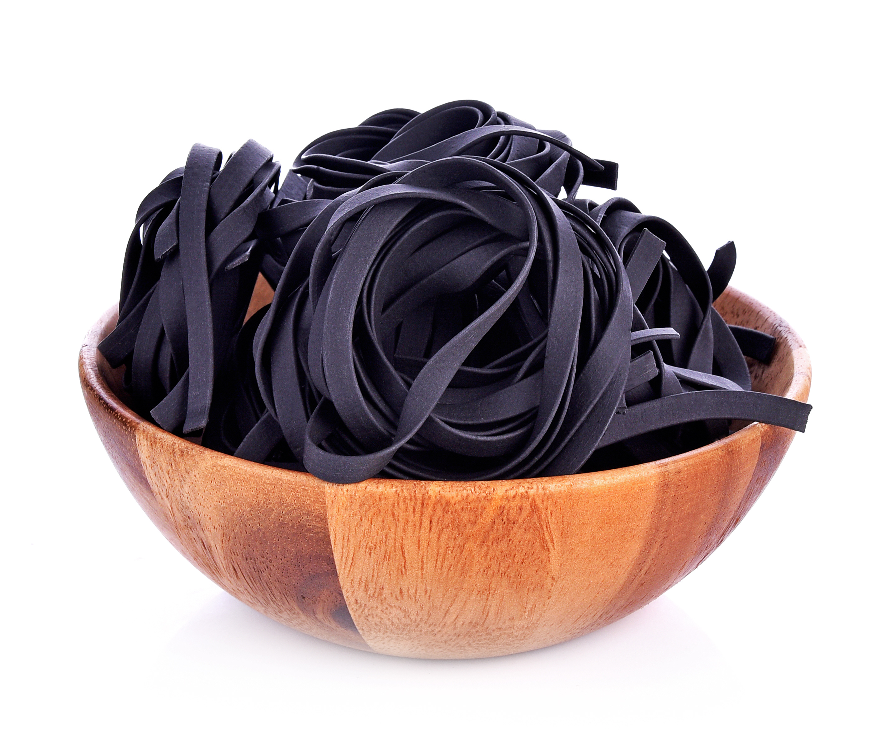 Squid ink pasta in bowl on white background