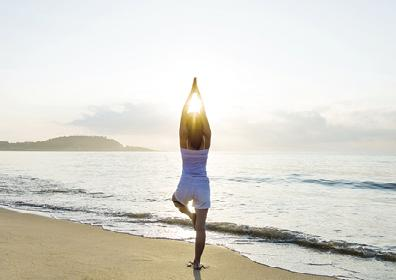 Pose for a Purpose - woman doing yoga on the beach