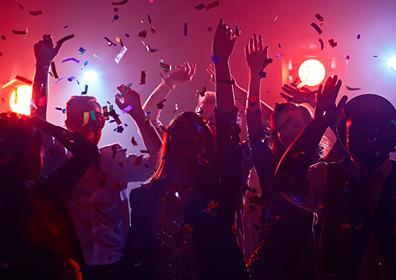 Crowd dancing enjoying a night out