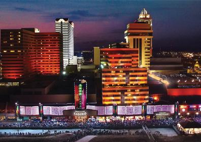 Photo of Tropicana Atlantic City building front exterior at night lit up with city lights