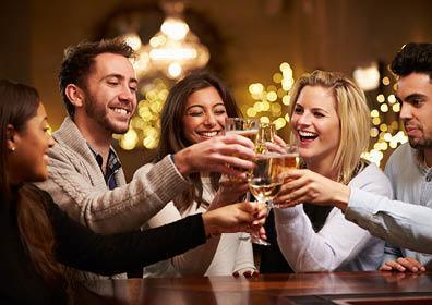 Tango's Lounge customers clinking glasses