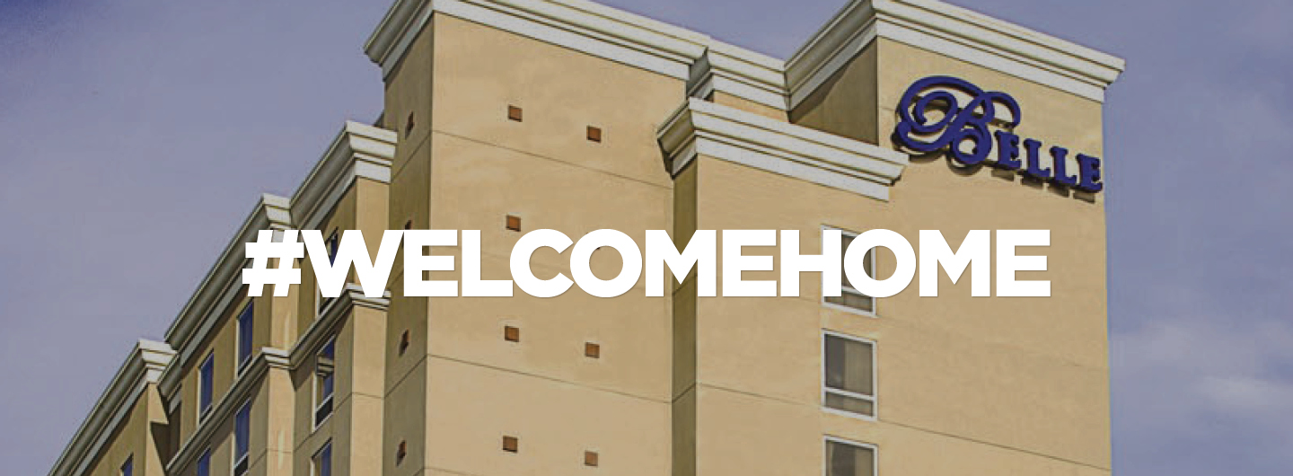 "Photo of Belle of Baton Rouge property exterior with the text overlay ""#WelcomeHome"""