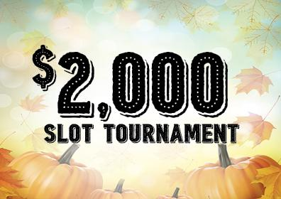 Blurred fall colors and leaves in background, pumpkins at the bottom with the words: $2,000 SLOT TOURNAMENT centered in all caps in black at the front.