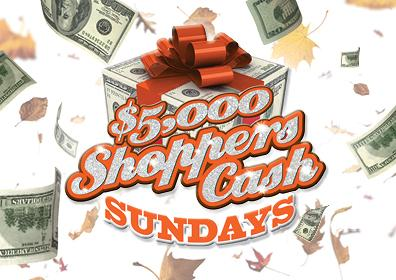 white background with flying  green money and various brown leaves  Center is a large orange bow on top of stacked money with the words: $4,500 Shoppers Cash SUNDAYS in orange centered.