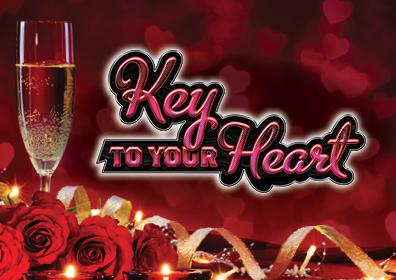 Flute of Champagne to the left, roses and ribbon at the bottom, red heart background.  Key To Your Heart in Hot pink cursive font with black shadow