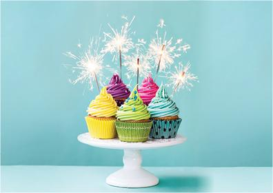 Graphic design:  Light blue background with cake stand with lighted cupcakes