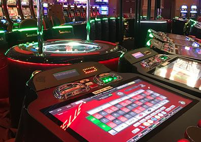 Picture of electronic table games inside a casino.