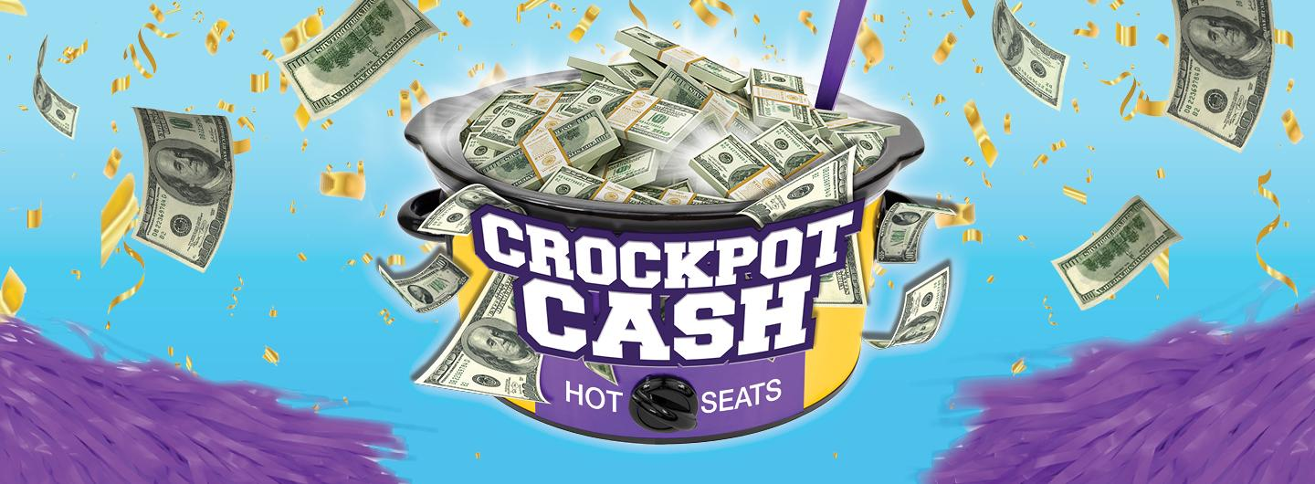 Sky blue background color, purple pompoms at the bottom corners, in the center is a picture of a purple & gold crockpot with the words CROCKPOT CASH HOT SEATS on the front.  The crockpot is filled with packs of money and single bills of different denominations are floating around.