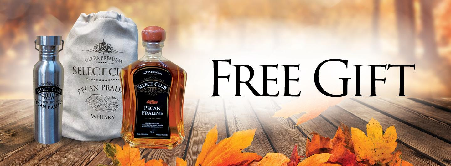 Fall colored background, to the left is a silver bottle, center is a beige drawstring sack, right is a glass bottle filled with whiskey, on each of these items are the words: Select Club, Pecan Praline Whiskey.  The right of the image has FREE GIFT in large black letters.