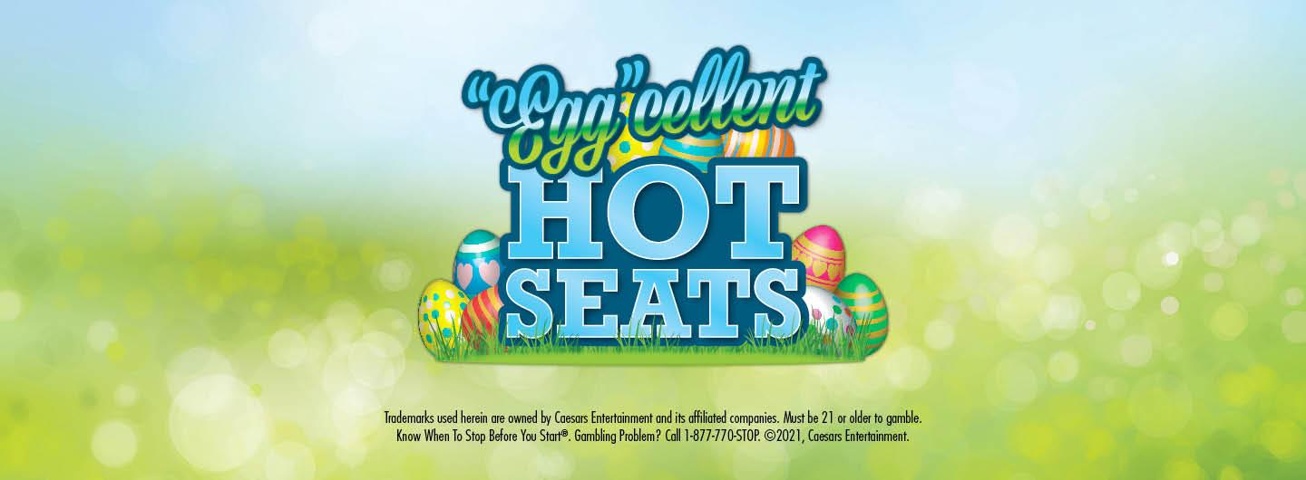 """Graphic Design:  Easter scene with eggs surrounding the words which are centered """"Egg""""cellent Hot Seats one above the other with the disclaimer underneath"""