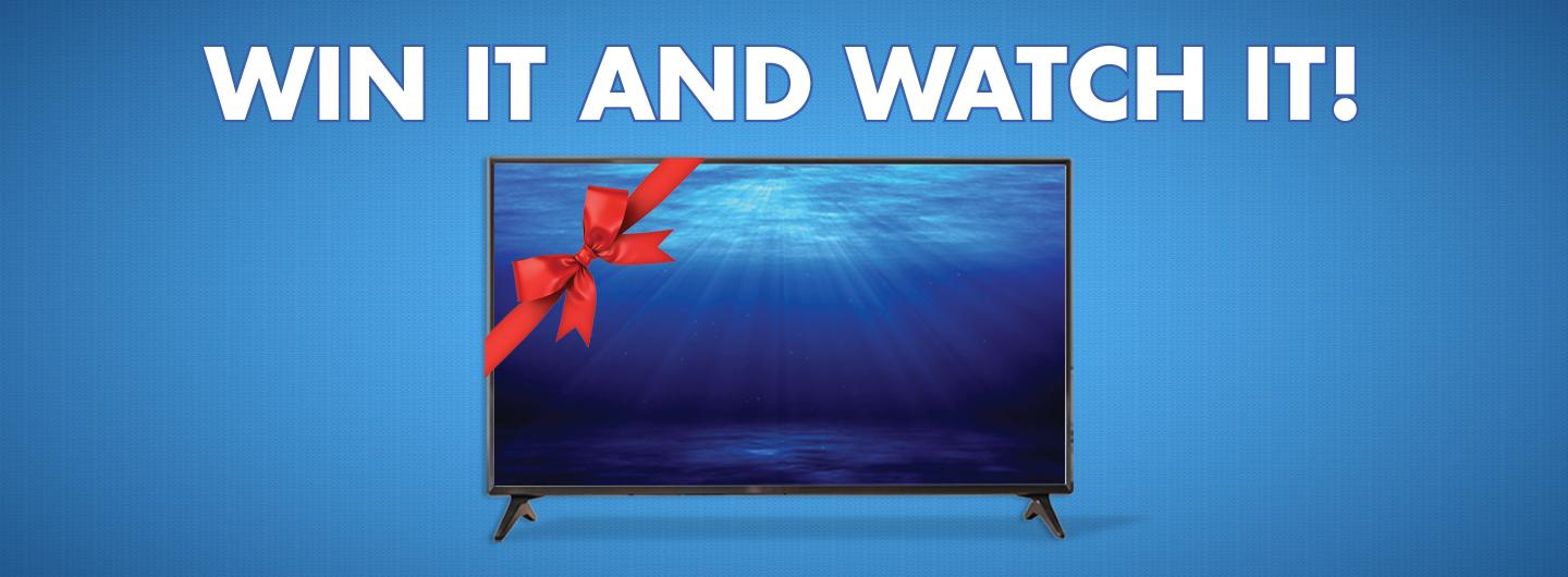 Graphic design:  Blue background with the words in white saying win it and watch it with a TV w/red bow underneath.