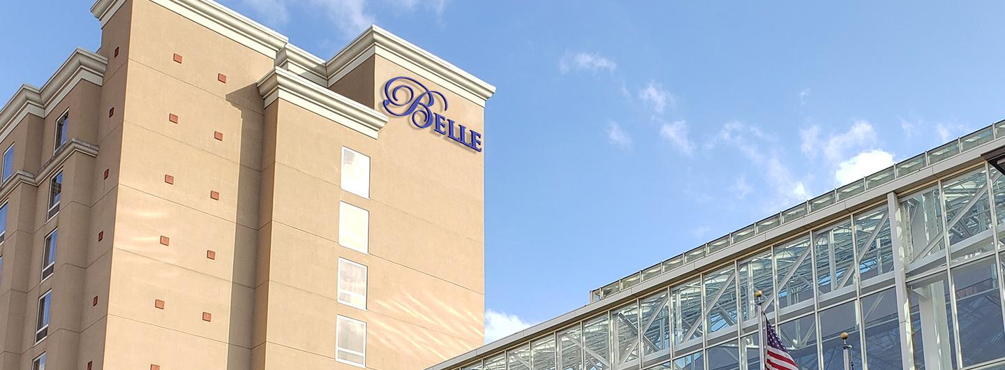 Belle of Baton Rouge hotel tower to the left of the photo with Belle at the top and the glass Atrium to the right of the photo.