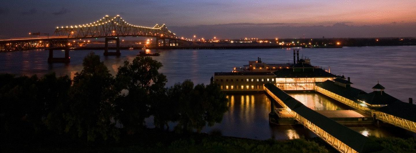 Beautiful Skyline photo at dusk of the Belle of Baton Rouge Casino on the Mississippi River.  The bridge is to the left of the photo and the casino is to the right.
