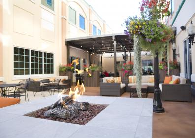 patio with fire pits, pergola and outdoor furniture