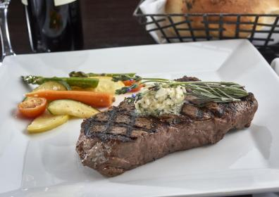 ribeye steak with garnish and steamed vegetables