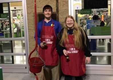 Ron and Judy-Kate ringing bells for the Salvation Army