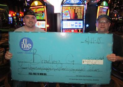 Bradley G with his $4,868.61 jackpot check