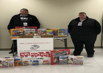 Brian McGown and Greg Brown with toys for Toys for Tots