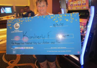 Kimberly F with her $1,944 jackpot check