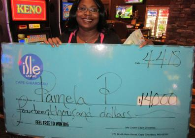 Photo of Pamela P with her $14,000 jackpot check