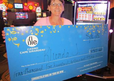 Photo of Rhonda J with her $4,500.66 jackpot check