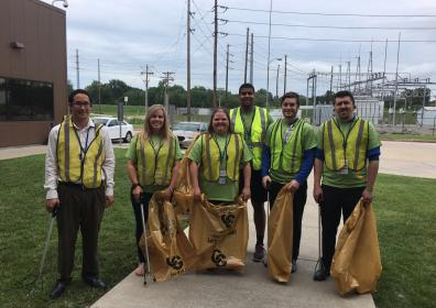 Image of team members with trash bags