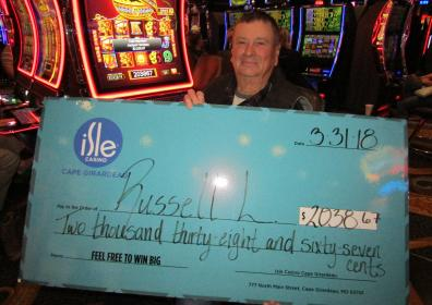 Photo of Russell L with his $2,038.67 jackpot check