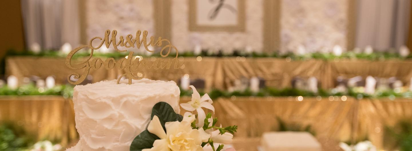 Upclose wedding cake and head table