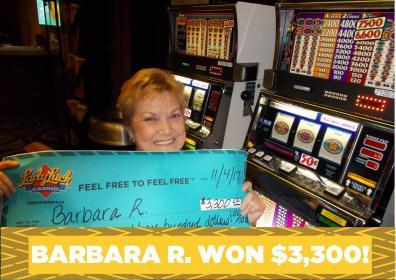 Barbara R. holding a jackpot check