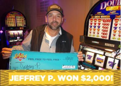 Jeffrey P. holding jackpot check