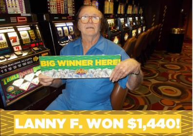 Lanny holding a jackpot sign!