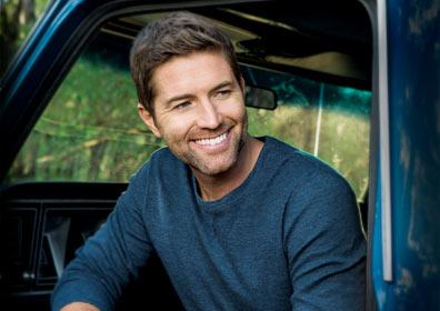 Josh Turner sitting in Truck smiling