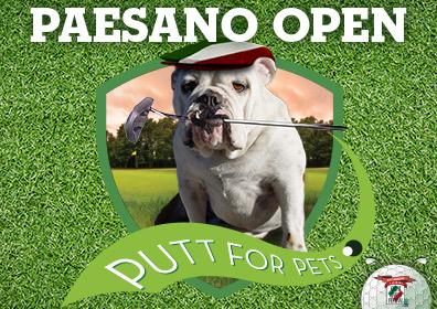 Cute dog with a golf club in its mouth