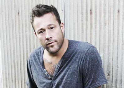 Uncle Kracker posing