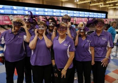 Women bowlers smiling