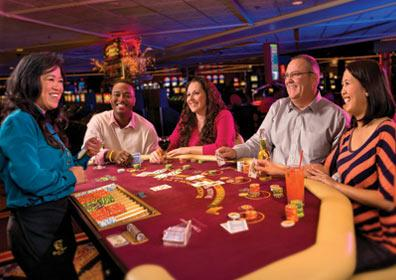 People playing table games at the casino.