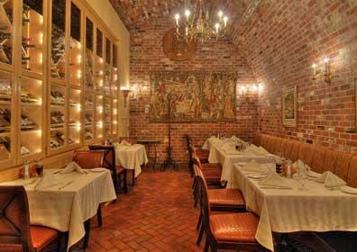 La Strada Restaurant Wine Cellar with Brick Walls and Fine Dining Tables