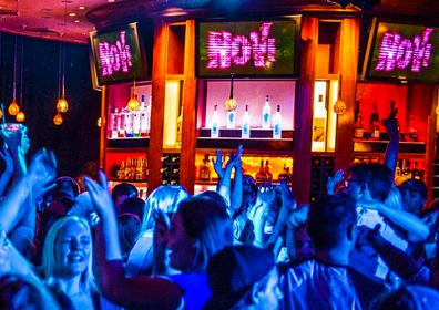 NoVi Bar and Crowd of Dancing Young People