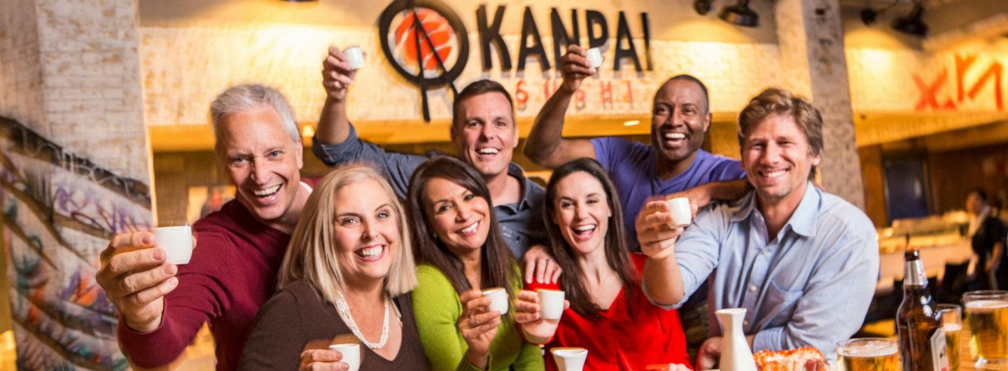 People having fun at Kanpai Sushi