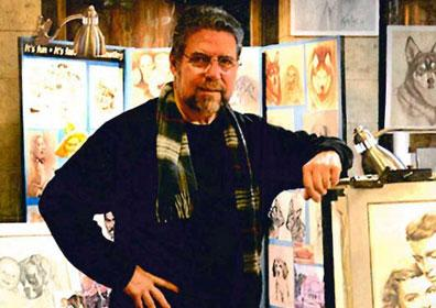 Artist Bob Napolitano next to some of his drawings and paintings
