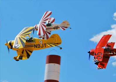 Yellow and Red Airplanes Flying through Air Race Track