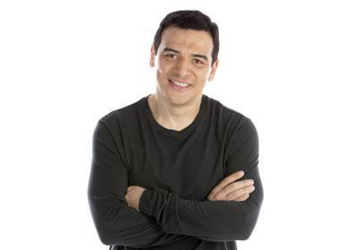 Carlos Mencia smiling