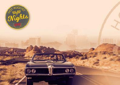 Classic car cruising down the freeway