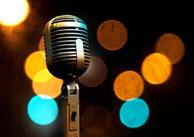 Old Microphone with Blue and Orange Lights Background