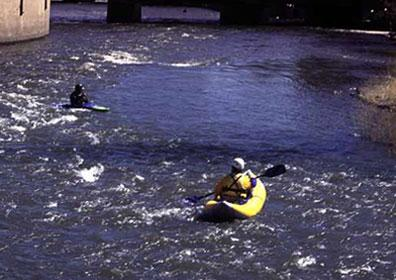 People Kayaking down the Truckee River